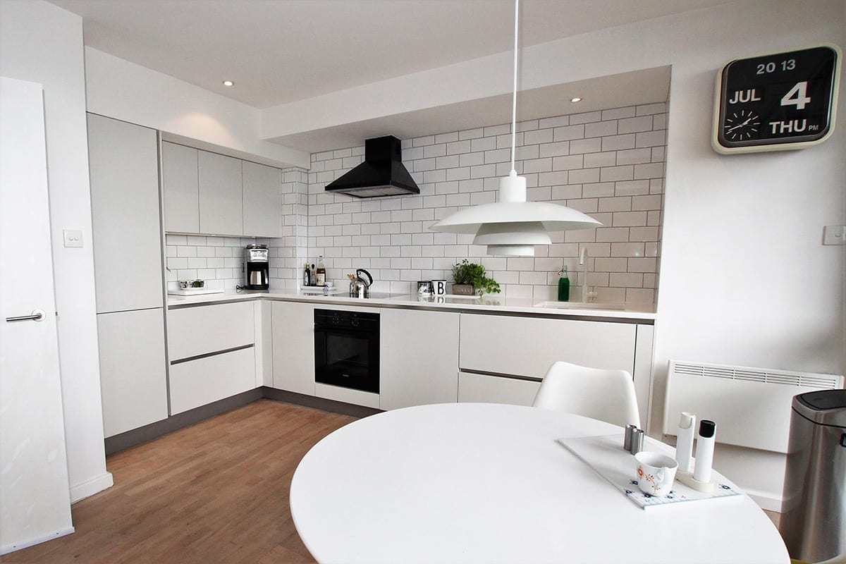1. Small all white kitchen design - Swans Of Gravesend