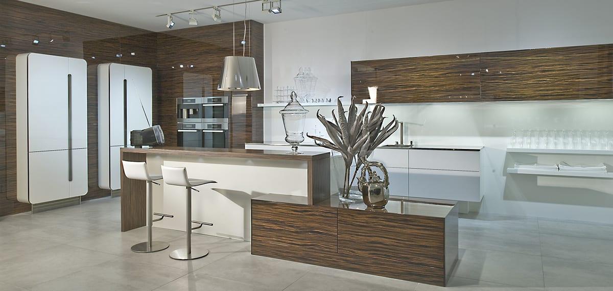 Macassar Ebony gloss veneer kitchen with white design glass 1200 - Net Kitchens Direct, Walthamstow