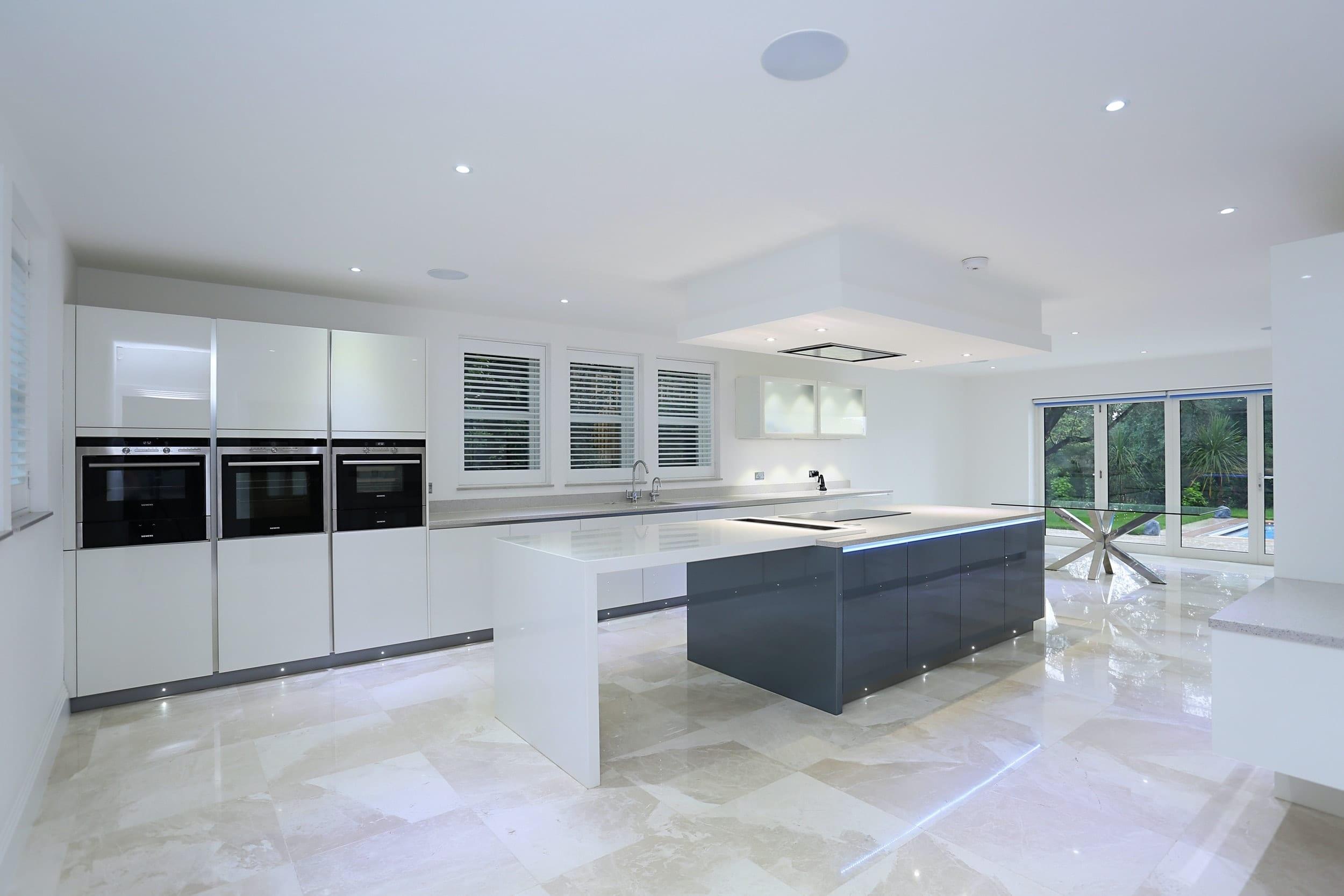 1. Handleless glass kitchen design 1 - Wooden Heart of Weybridge